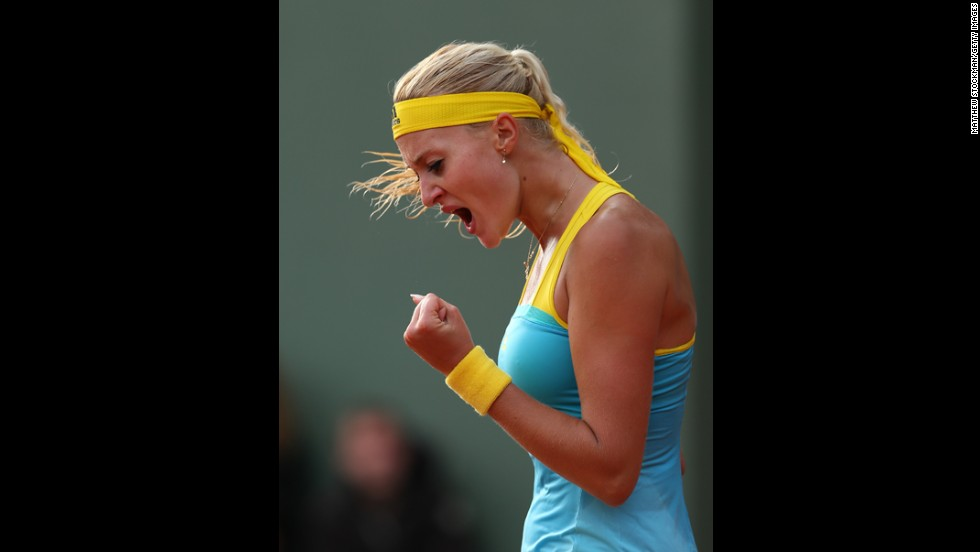 Kristina Mladenovic of France celebrates a point in her women's singles match against Lauren Davis of the United States on May 28. Mladenovic won 6-0, 7-5.