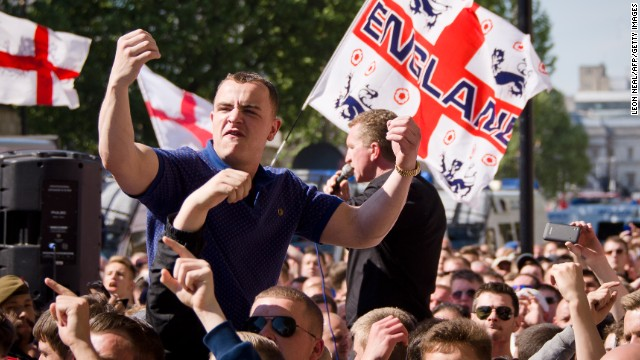 A supporter of the far-right English Defence League gestures at an anti-Muslim rally on May 27 after a British soldier was killed.