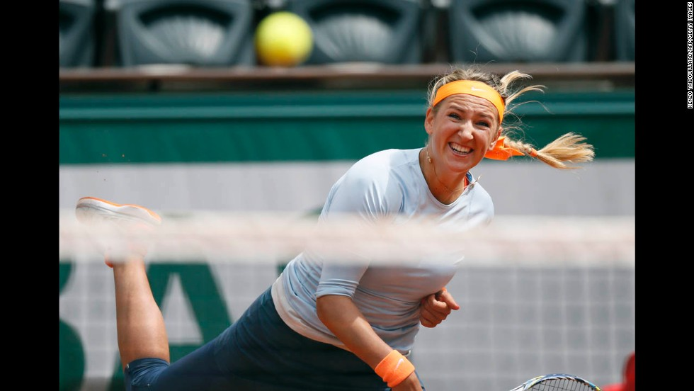 Belarus' Victoria Azarenka serves to Russia's Elena Vesnina on May 29.
