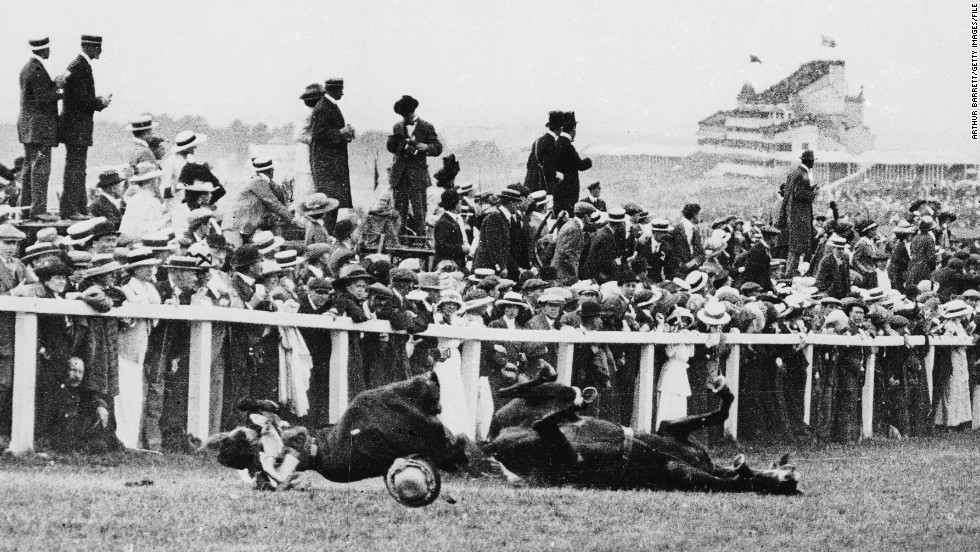 In a shocking instant, Suffragette Emily Davison is knocked to the ground by the King's horse during the 1913 Epsom Derby. Yet take a closer look and you'll see the majority of spectators are instead watching the race.