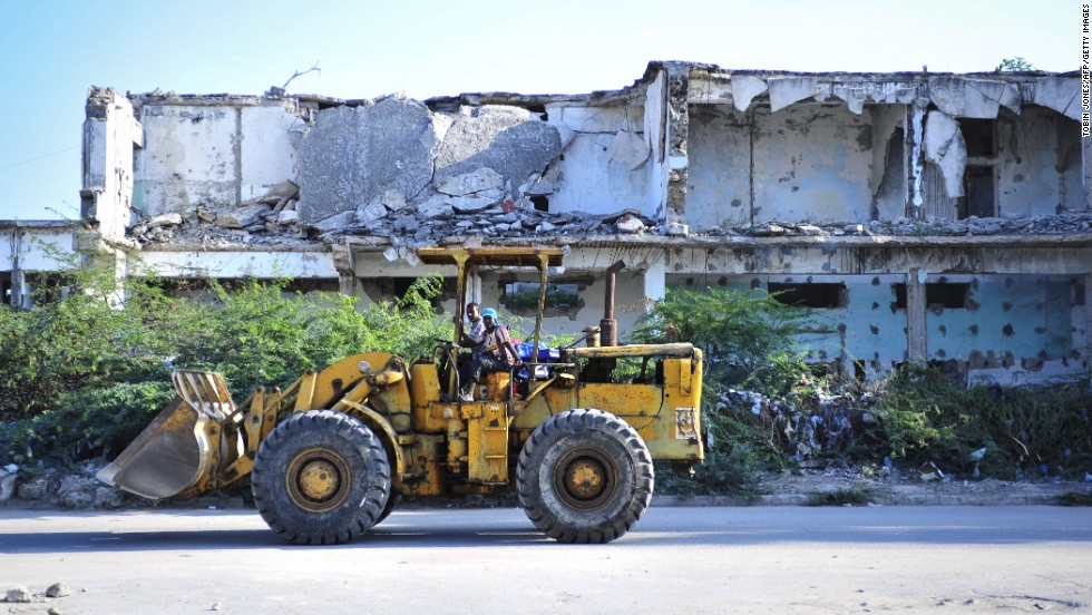 Business activity is gradually returning to Mogadishu as the capital of war-ravaged Somalia tries to recover after more than 20 years of conflict. Pictured, construction workers in November 2012.