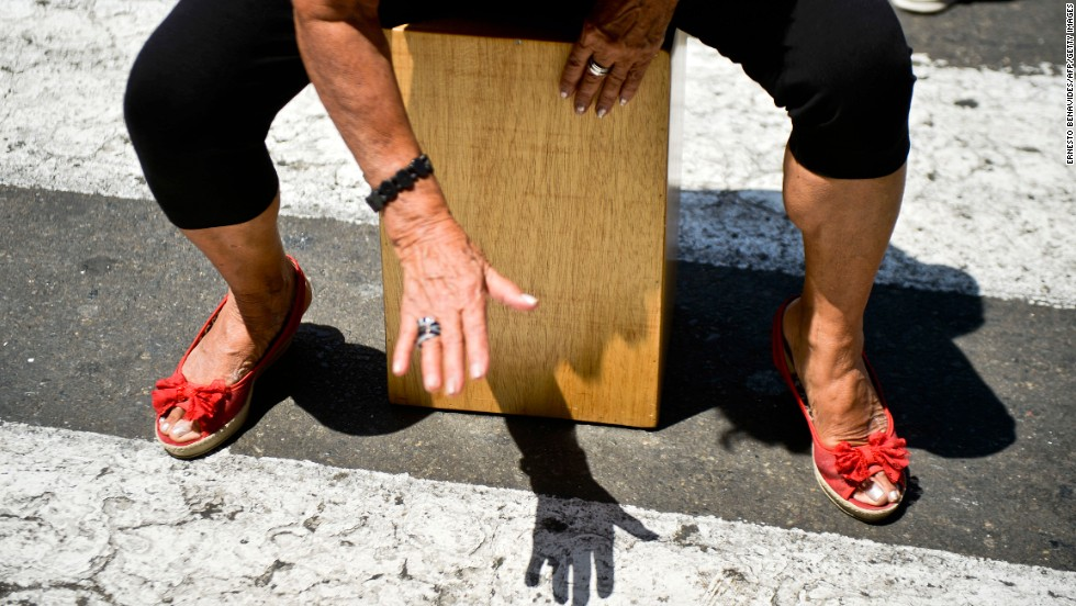 A woman plays a cajon, a box-shaped percussive instrument of Afro-Peruvian origin, during the International Peruvian Cajon Festival in Lima on April 13.