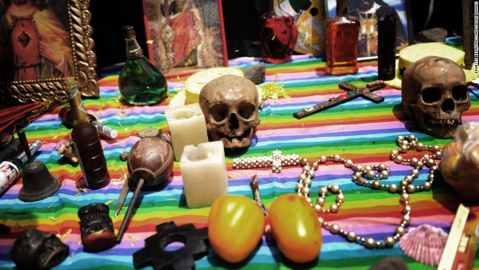 Items are laid out on a table while shamans practice a ritual of making predictions for the new year at San Cristobal Hill in Lima in December 2009.