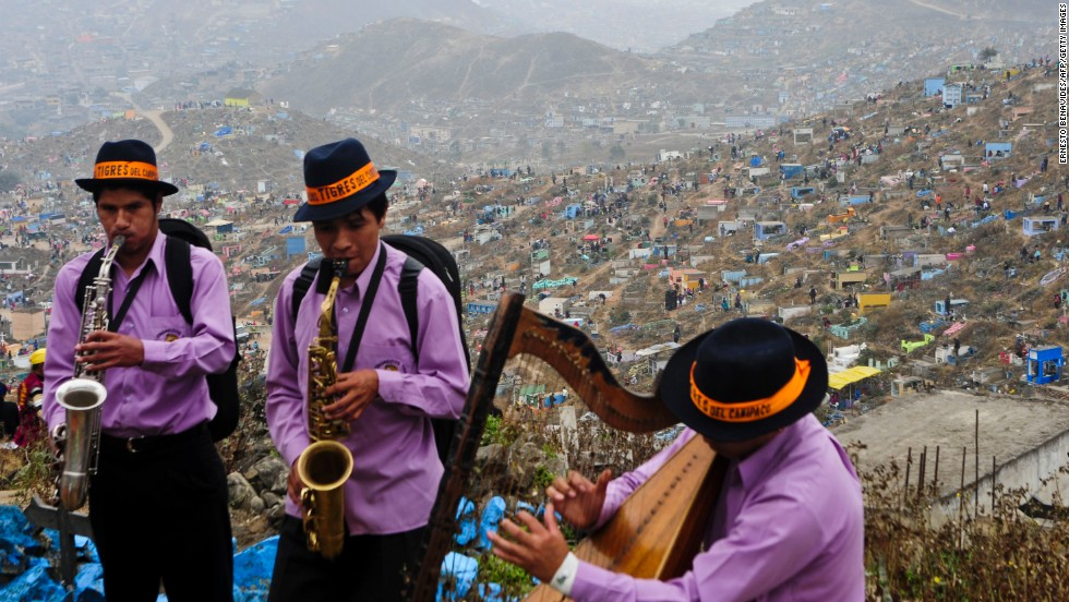 Musicians perform at the Nueva Esperanza cemetery on the outskirts of Villa Maria del Tiunfo in Lima during All Saints Day celebrations in 2011.
