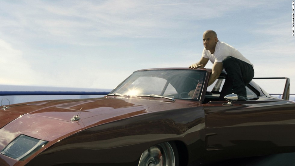 "The good guys never, ever fall off that fast-moving car. They will hold on by their fingertips, hold on with one hand or even leap from said vehicle. But, like Vin Diesel here in ""Fast and Furious 6,"" they always stay perfectly perched."