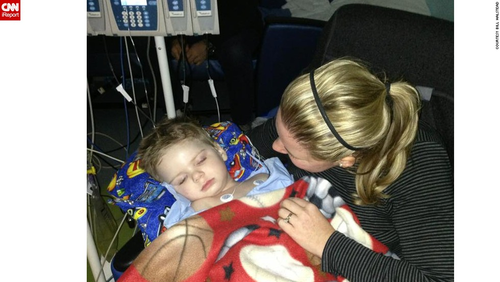 Halstead comforts Tripp at the hospital in February. She had just learned he contracted meningitis and had heart inflammation. Doctors informed Stacey and Bill that their son would need another surgery to replace a pump near his brain.