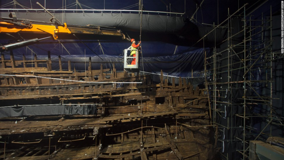 Conservators work on the remains of the Mary Rose at the new Mary Rose Museum at Portsmouth's Historic Dockyard on May 16, 2013 in Portsmouth, England.
