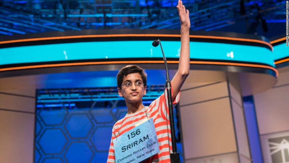 "Sriram J. Hathwar, representing New York, waves goodbye after misspelling ""ptyalagogue,"" during the championship round on May 30."
