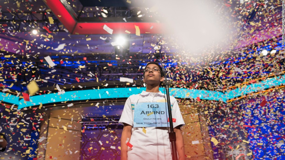 Confetti falls on Mahankali after he won the bee.