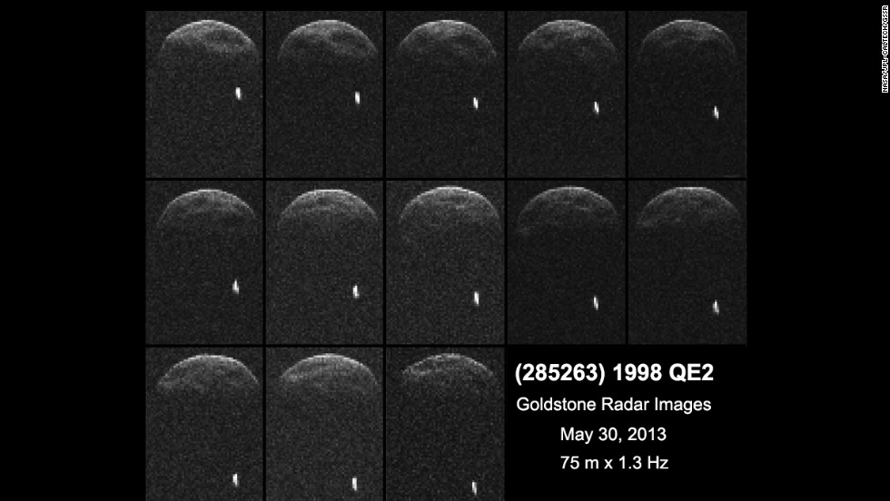 Asteroid 1998 QE2 is about 3.75 million miles from Earth. The white dot is the moon, or satellite, orbiting the asteroid.