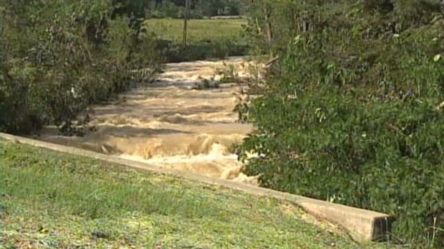 Sheriff swept away by floodwaters
