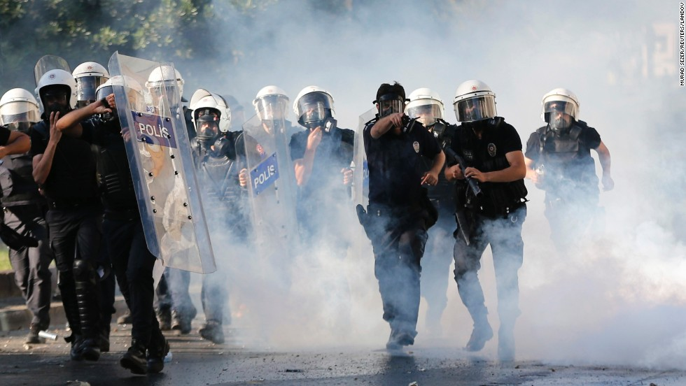 Riot police use tear gas in an attempt to disperse the crowd of demonstrators on June 1.