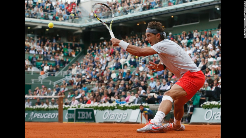 Spain's Rafael Nadal returns to Italy's Fabio Fognini on June 1. Nadal took the match 7-6(5), 6-4, 6-4.
