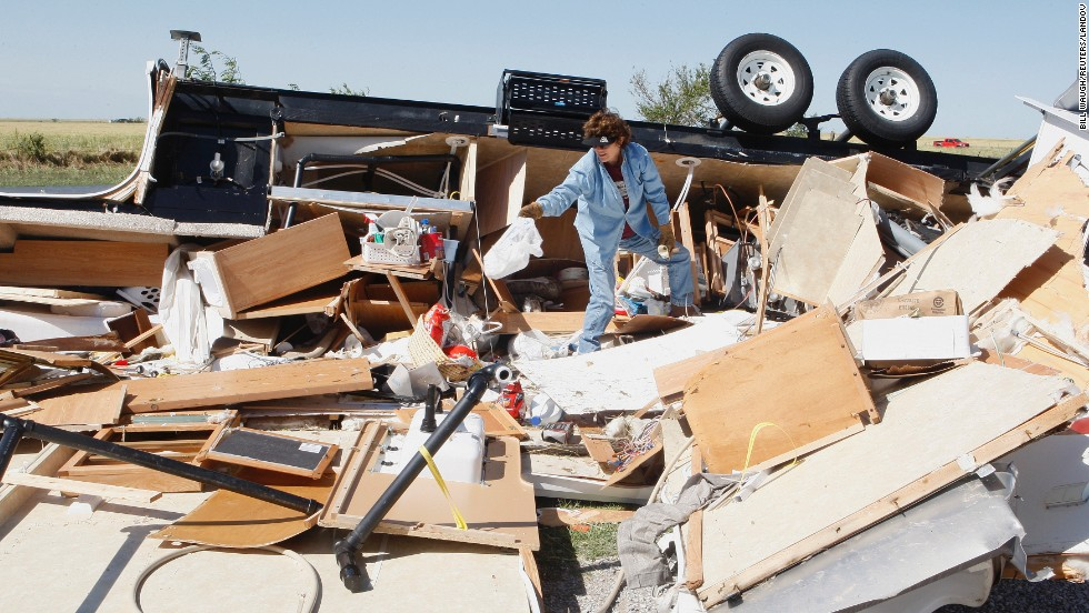 Mikie Hooper collects her belongings from her RV, which was destroyed by a tornado in El Reno, Oklahoma, on June 1.