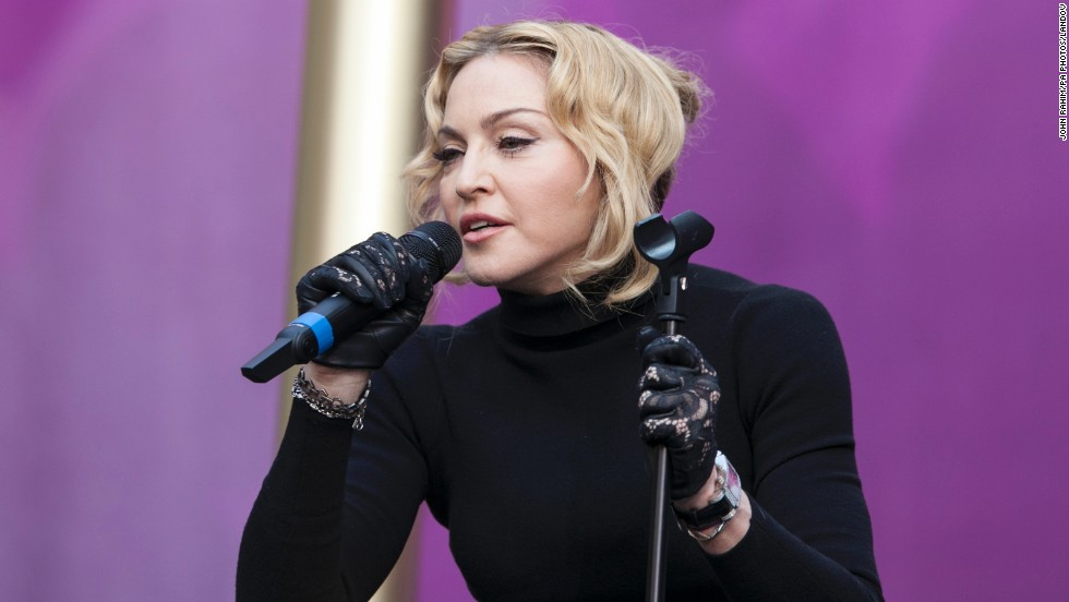 "Madonna speaks during the concert. She asked the audience to help her start a ""revolution of love,"" focusing on education."