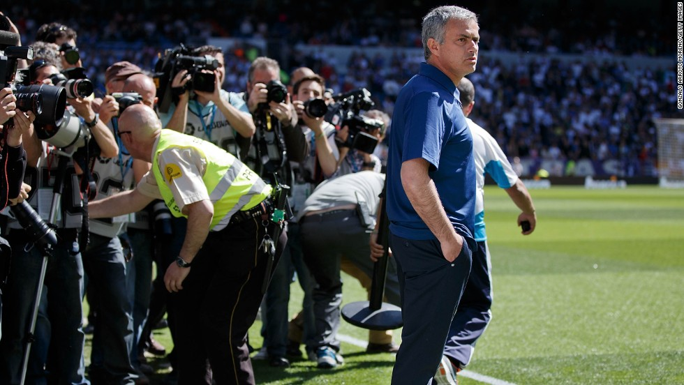 Photographers gather around Jose Mourinho during his last match as coach of Real Madrid, a 4-2 win at home to Osasuna. Real finished the season 15 points behind Spanish champions Barcelona.