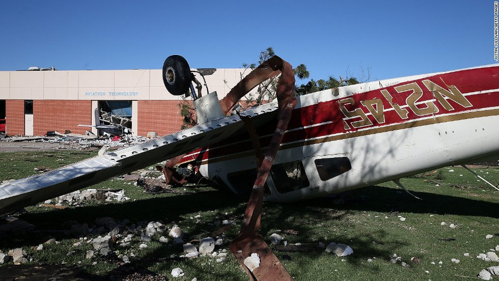 An overturned airplane sits amid rubble at the Canadian Valley Technology Center in El Reno on June 1.