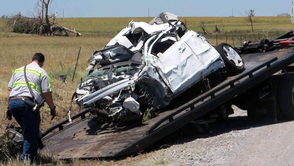 Crews haul away a mangled truck on Sunday, June 2, that storm chasers Tim Samaras, his son Paul Samaras and Carl Young were using to track the tornado that hit El Reno, Oklahoma. The three men, who had devoted their lives to hunting powerful storms died in the middle of the chase. Seventeen tornadoes were reported in the Oklahoma City and St. Louis areas on Friday, May 31.
