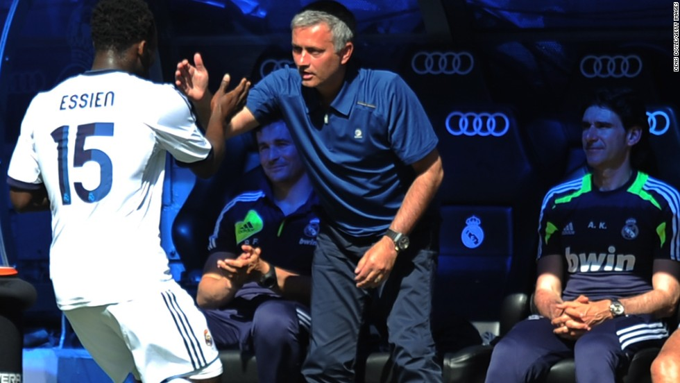 Mourinho celebrates with Michael Essien -- who he worked with at Chelsea and brought to Madrid this season -- after the midfielder put Real 2-0 up against Osasuna.