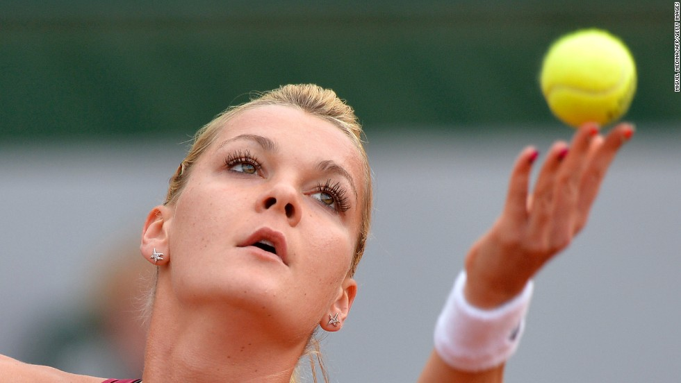 Poland's Agnieszka Radwanska serves to Serbia's Ana Ivanovic on June 2. Radwanska won 6-2, 6-4.