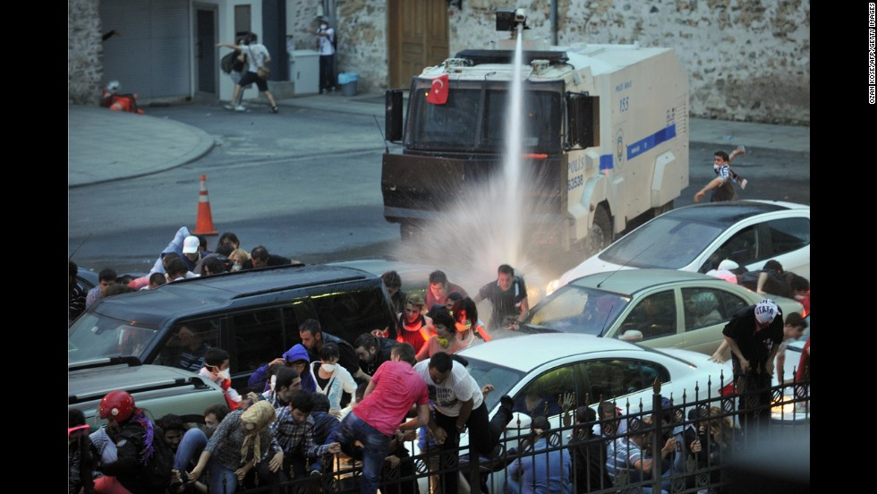 Police use a water cannon to disperse protesters outside Turkish Prime Minister Recep Tayyip Erdogan's working office in Istanbul on June 2.
