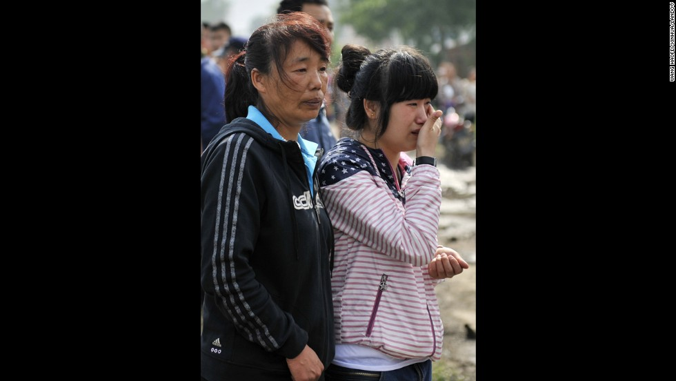 Two women wait for news about a family member. It took six hours to bring the fire under control.