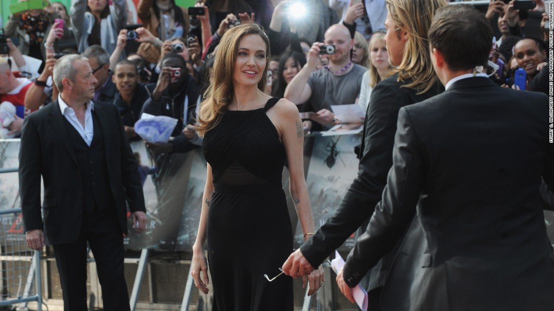 """In May 2013, Jolie announced in <a href=""""http://www.nytimes.com/2013/05/14/opinion/my-medical-choice.html"""" target=""""_blank"""">a New York Times op-ed </a>that she underwent a preventive double mastectomy after learning that she carries a mutation of the BRCA1 gene, which sharply increases her risk of developing breast and ovarian cancer. Here, in June 2013, she makes her first red carpet appearance since the surgery, attending the London premiere of Pitt's movie """"World War Z."""""""