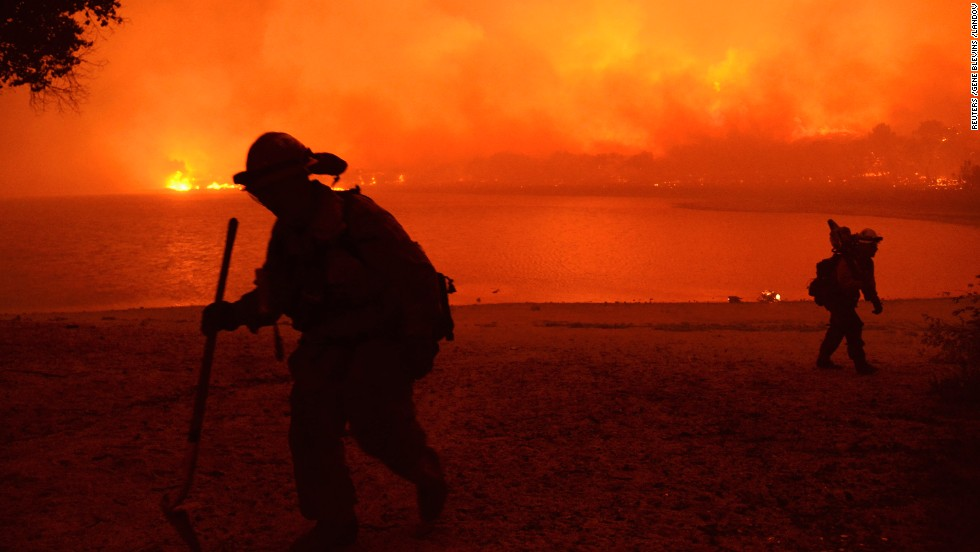 Firefighters battle the Powerhouse wildfire at the Angeles National Forest on Saturday, June 1.