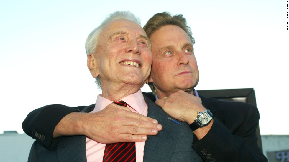 "At the premiere of ""It Runs In The Family,"" in  April 2003, Douglas and his father, actor Kirk Douglas, left, embrace at the Bruin Theater in Los Angeles."