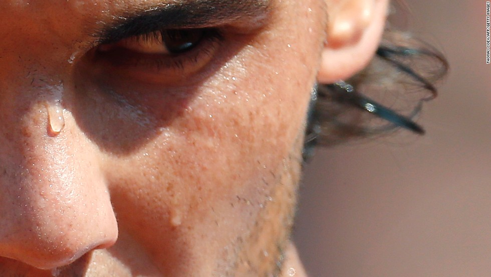 Sweat runs down the face of Spain's Rafael Nadal during his match against Japan's Kei Nishikori at the French Open on Monday, June 3, in Paris.
