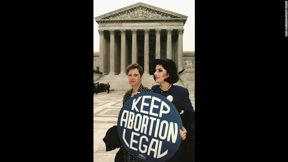 "<strong>Roe v. Wade (1973):</strong> Norma McCorvey, identified as ""Jane Roe,"" sued Dallas County District Attorney Henry Wade over a law that made it a felony to have an abortion unless the life of the mother was in danger.  The court agreed with Roe and overruled any laws that made abortion illegal in the first trimester. Here, McCorvey, left, stands with her attorney Gloria Allred in 1989."