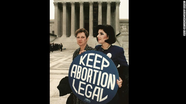 WASHINGTON, DC - APRIL 26, 1989: This file photo shows Norma McCorvey(L) formally known as 'Jane Roe,' as she holds a pro-choice sign with former attorney Gloria Allred(R) in front of the U.S. Supreme Court building in Washington,DC, just before attorneys began arguing the 1973 landmark abortion decision which legalized abortion in the US. (Photo credit GREG GIBSON/AFP/Getty Images)