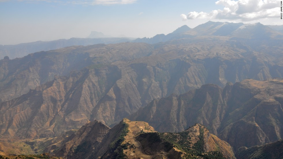 The Simien mountains are one of Africa's largest ranges. Ras Dashen, the highest peak in Ethiopia, reaches an elevation of 4,550 meters (14,928 feet). A UNESCO World Heritage Site, the mountain is rich in wildlife, including gelada baboons, walia ibex, Ethiopian wolf and birds of prey.