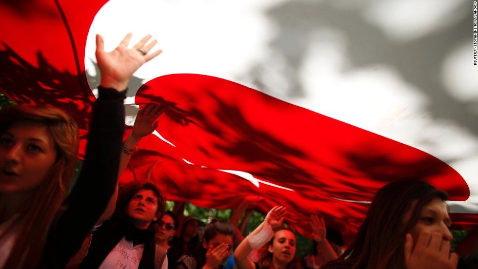 Despite Turkish Prime Minister Recep Tayyip Erdogan's call for calm on Monday, June 3, protests continued in Istanbul. Protesters carry the Turkish flag and shout against the government in Gezi Park near central Istanbul.