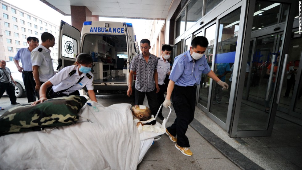 An injured worker is wheeled into a hospital in Changchun.