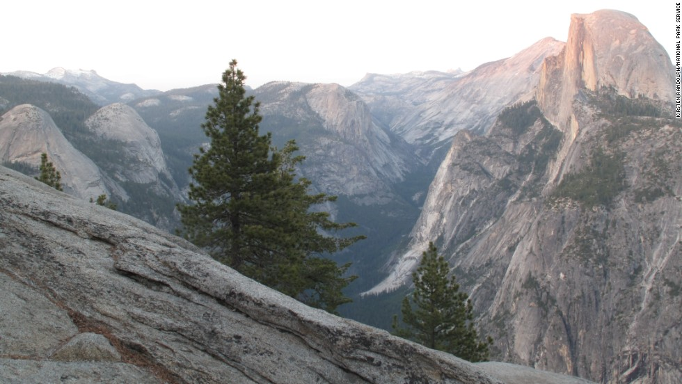 Drive up to Glacier Point to get a sense of Yosemite's size and get an impressive view of Half Dome (seen here at sunset from Glacier Point).