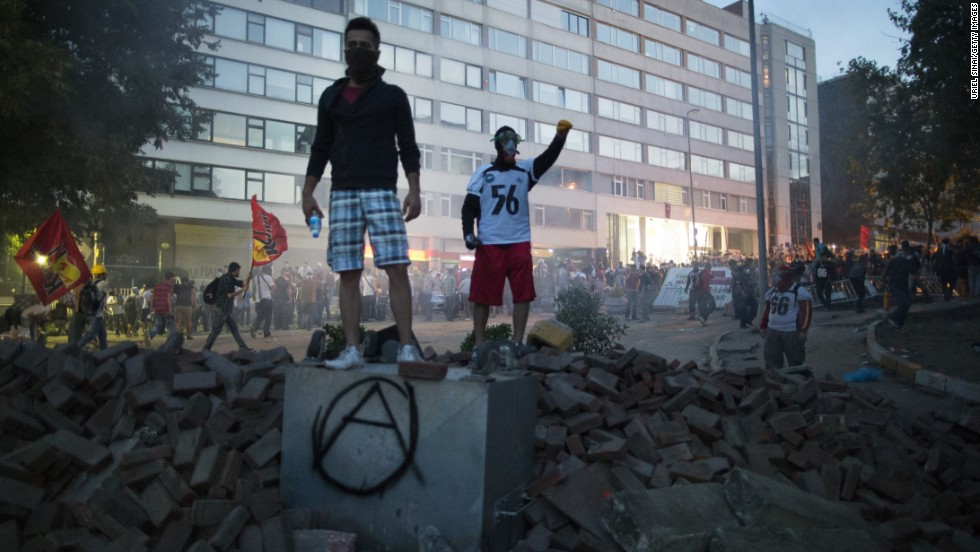 Protesters stand atop a pile of rubble during clashes with Turkish police on Monday, June 3.