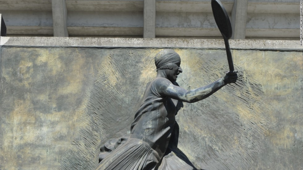 Lenglen never played at Roland Garros, which was built after she retired in 1927, but the second show court there has since been named after her -- and the statue outside commemorates one of her most iconic action images.