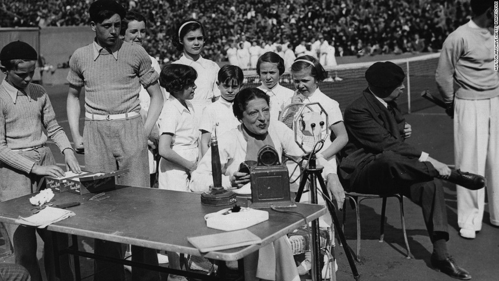 After retiring, Lenglen helped set up a tennis school near Roland Garros. She is pictured here with students in 1937, a year before her death at the age of 39. She had long suffered poor health, and was diagnosed with leukemia not long before she died.
