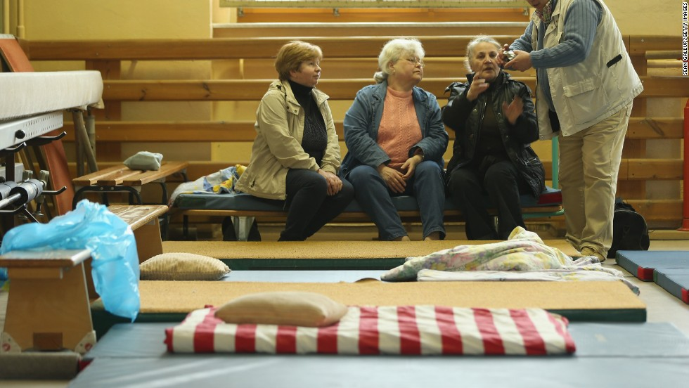 Evacuees  forced to flee the rising floodwaters of the Weisse Elster River sit on mattresses at an evacuation center in a school gymnasium in Zeitz, Germany, on June 3.