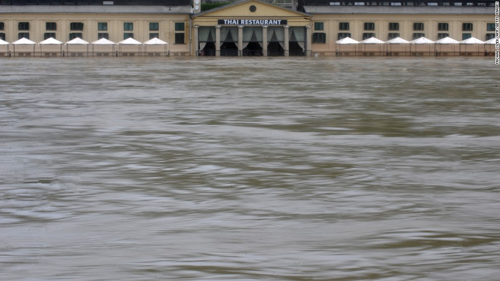 Floodwaters surround a restaurant in Prague on June 3.