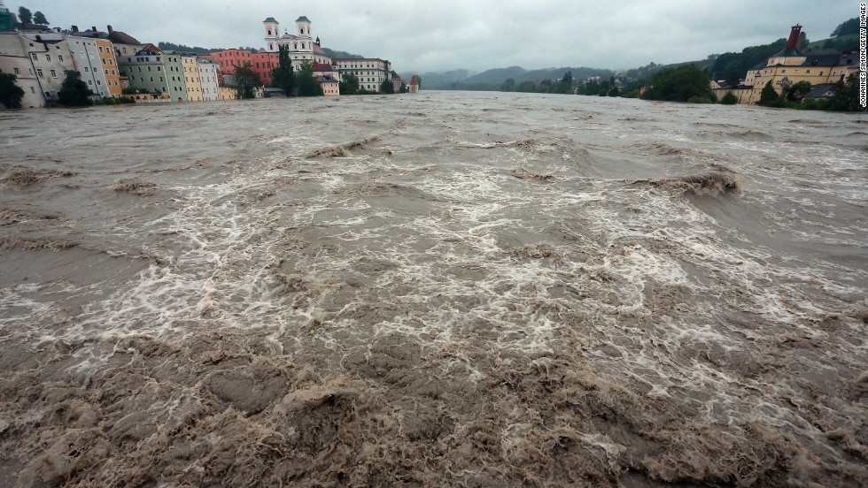 The swollen Inn River rushes through downtown Passau, Germany, on June 3.