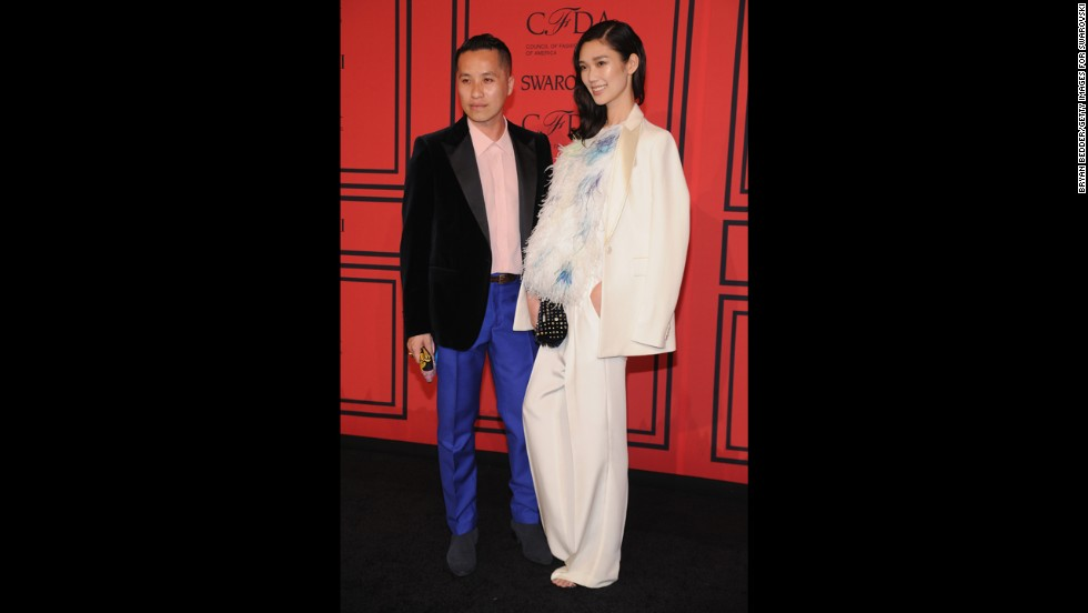 "<a href=""http://cfda.com/members#!phillip-lim"" target=""_blank"">Phillip Lim</a>, winner of the Accessories Designer of the Year award, arrives at the ceremony with <a href=""http://www.fashionologie.com/Models-Celebrities-Designers-CFDA-Awards-2013-30698431?slide=27&image_nid=30698447"" target=""_blank"">model Tao Okamoto</a>."