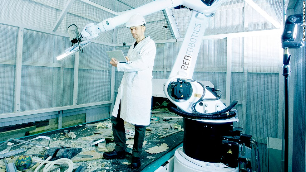 ZenRobotics Principal Scientist, Dr. Harri Valpola adjusts the robot of the ZRR system.