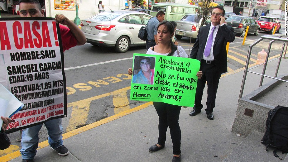 "What happened to 12 young people who were forced at gunpoint into a van in Mexico City's popular Zona Rosa entertainment district on May 26? <a href=""http://www.cnn.com/2013/06/04/world/americas/mexico-missing-mystery/index.html?iref=allsearch"">The mystery has gripped nation</a>. Penelope Ramirez is a cousin of Jerzy Ortiz Ponce, who is one of the 12 missing people. She holds a sign with his picture during a gathering of family members in the Tepito area of Mexico City on May 31."