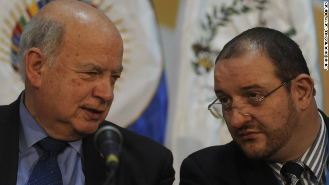 Organization of American States' (OAS) Secretary General Jose Miguel Insulza (L) and Guatemalan Minister of Foreign Affairs Luis Fernando Carrera deliver a press conference in Guatemala City on June 3, 2013, a day before a meeting of the OAS.