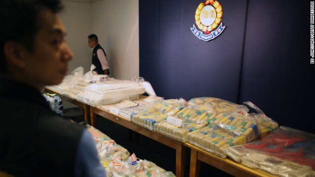 A policeman guards a selection of confiscated cocaine from one of the largest hauls in Hong Kong history on September 18, 2011.