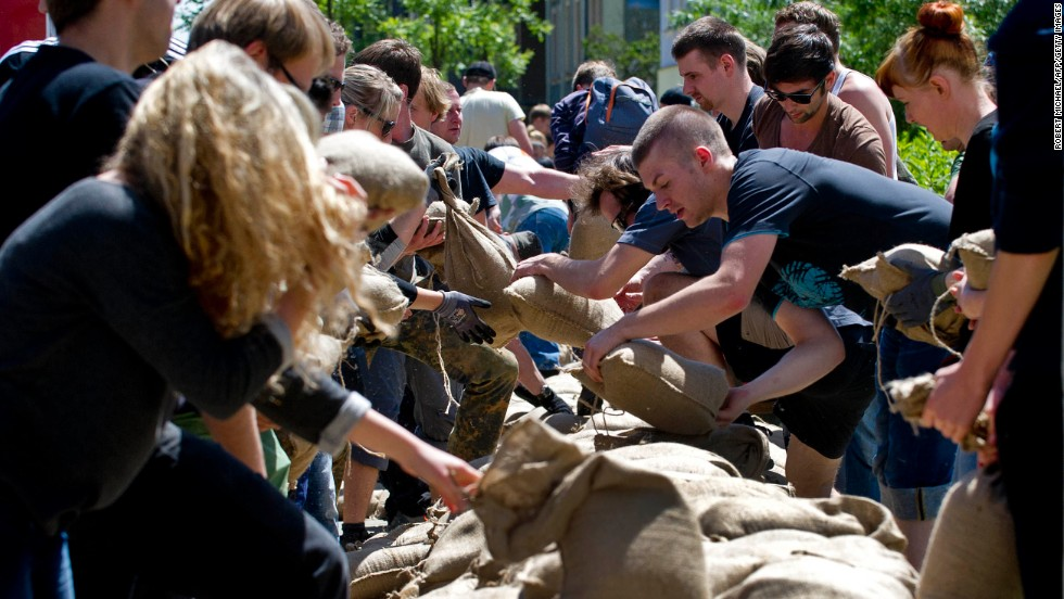 Residents transport sandbags to build a flood wall in a street flooded by the Elbe River in Dresden, Germany, on June 5.