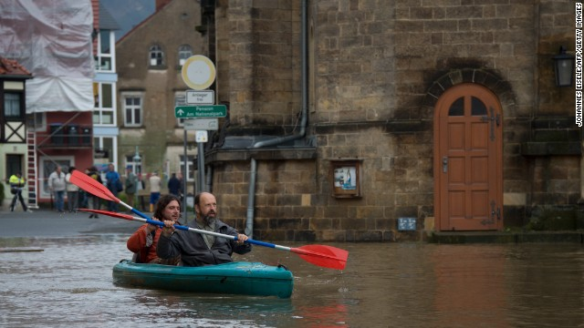 People canoe in the flooded city of Wehlen, in eastern Germany, on June 4, 2013. Torrential rain and heavy flooding hit central Europe. AFP PHOTO / JOHANNES EISELE (Photo credit should read JOHANNES EISELE/AFP/Getty Images)