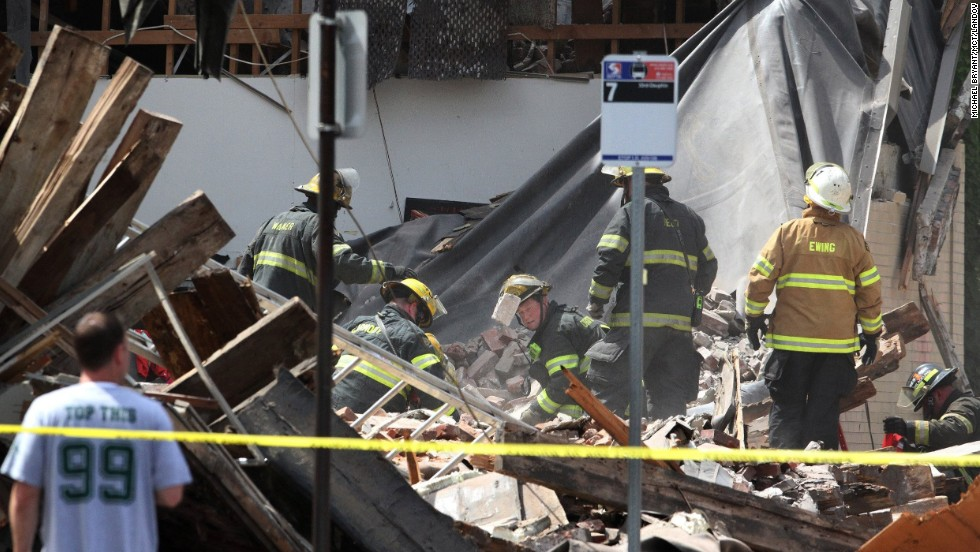 Firefighters search through the rubble looking for survivors.